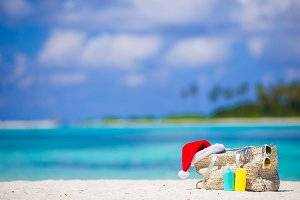 Beach accessories with Santa Hat on white tropical beach