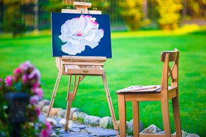 Closeup an easel with beautiful picture in beautiful garden