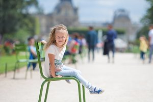 Adorable fashion little girl outdoors in European city, Paris, France