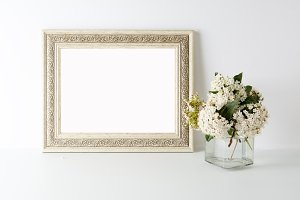 Empty picture frame with flowers