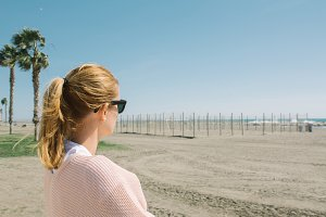 Blonde woman watching the sea