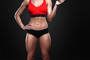 Beautiful sportly fitness girl holding an apple