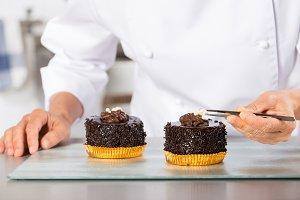 Chef finishing a cake