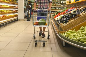 Guy walking with shopping trolley