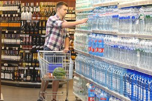 man buying water at the supermarket