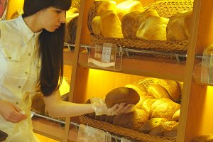Woman chooses a fresh bread