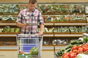 Guy choosing fresh vegetables