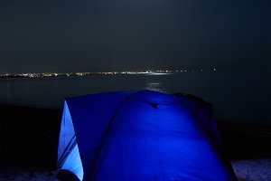 Blue illuminated tent at night