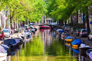 Beautiful canal in the old city of Amsterdam, Netherlands, North Holland province.