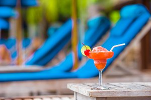 Tasty alcoholic cocktail background swimming pool