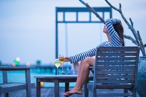 Young happy woman relaxing at evening on summer vacation
