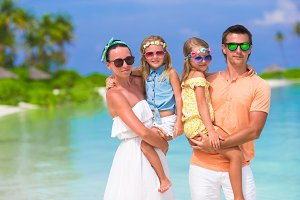 Beautiful family during summer tropical vacation