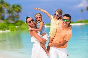 Happy family during summer vacation having fun