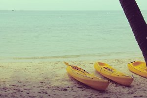 Yellow kayaks on the beach