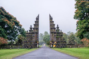 Traditional Balinese Hindu gate at rainy summer day with clouds - Candi Bentar, Bedugul in Bali, Indonesia.