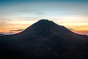Summer view of vivid orange sunrise lights in Batur mountain, Kintamani, Bali, Indonesia.