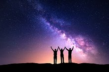 Milky Way. Silhouette of friends