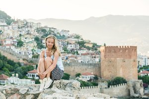 Woman relaxing on ancient fortress