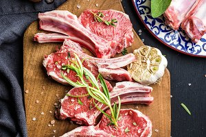 Raw uncooked lamb chops with herbs