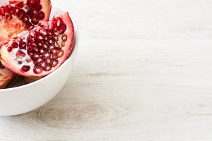 Pomegranate on white wooden table