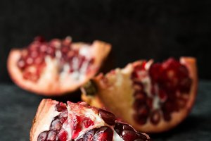 Pomegranate on slate background
