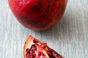 Pomegranate on blue background