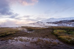 The colorful geyser landscape at the Haukadalur geothermal area, part of the golden circle route, in Iceland