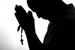 man hands in a prayer