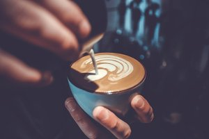 Making of latte art by barista
