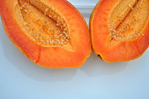 cut papaya on white