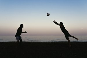 Two friends playing soccer.