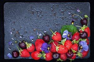 Ripe strawberry and cherry