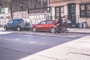 Woman Riding a Bike, Brooklyn Street