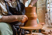 Ceramist working in his potter wheel