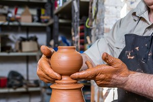 Ceramist working in his potter wheel
