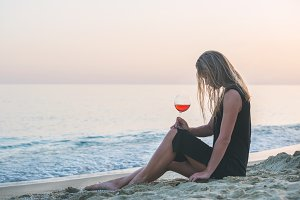 Woman relaxing with glass of wine