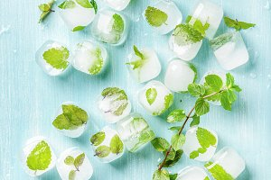Ice cubes with frozen mint leaves