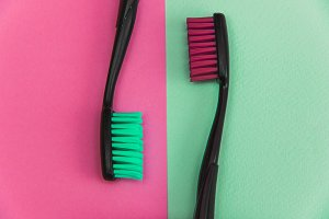 green and pink toothbrushes