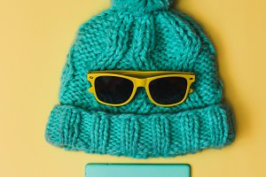 mint colored cap and smartphone