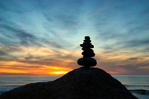 Cairn at sunset on the sea