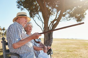 Senior couple relaxing on a park