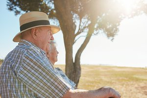Elderly couple relaxing outdoors