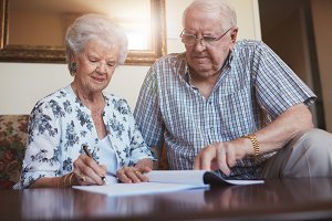 Senior couple doing paperwork