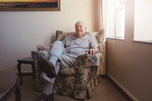 Relaxed elderly man sitting