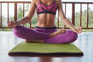 Fitness female meditating