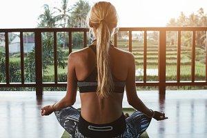 Fitness woman doing meditation