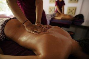 Masseuse massaging woman