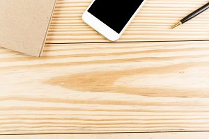 Office table mockup with smartphone