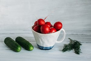 red radish in a white ceramic mug