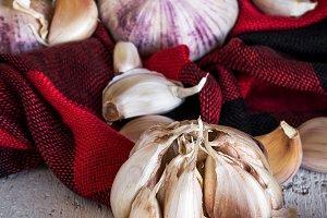 Purple garlics on a napkin